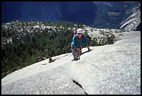 Rock climbers on the Snake Dike route, Half-Dome. Yosemite National Park, California (color)