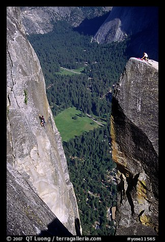 Climbers on Lost Arrow spire and Yosemite falls wall. Yosemite National Park, California