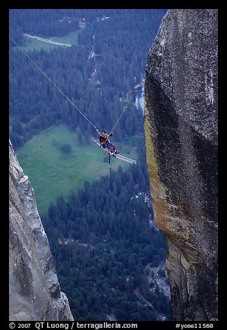 [photo by Bryce Nesbitt] Tyrolean traverse from Lost Arrow Spire. Yosemite National Park, California (color)