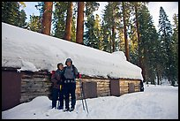 Skiing couple in front of the Mariposa Grove Museum in winter. Yosemite National Park, California (color)