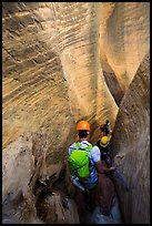Canyoneers surrouned by tall walls in narrow section of Mystery Canyon. Zion National Park, Utah ( color)