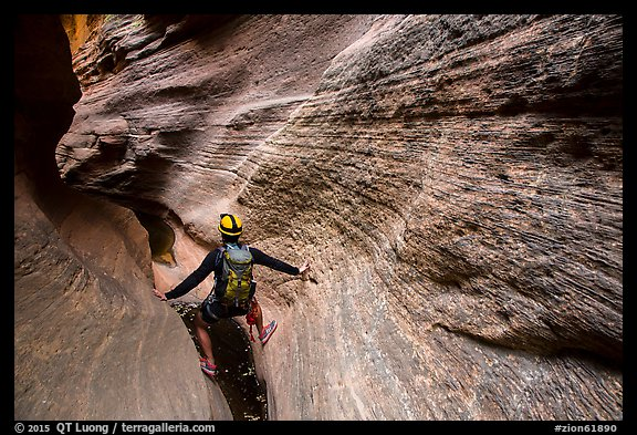 Hiker in slot canyon, Mystery Canyon. Zion National Park, Utah (color)