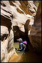 Canyoneer in sunny pool of water, Pine Creek Canyon. Zion National Park, Utah ( color)