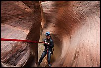Canyoneer descending Keyhole Canyon using a sling. Zion National Park, Utah ( color)