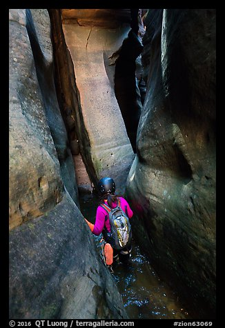 Canyoneer in tight squeeze, Das Boot Canyon. Zion National Park, Utah (color)