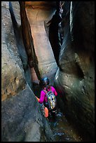 Canyoneer in tight squeeze, Das Boot Canyon. Zion National Park, Utah ( color)