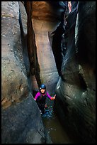 Canyoneer in tight and wet section of Das Boot Canyon. Zion National Park ( color)