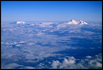 Summit of Mt Foraker and Mt Mc Kinley emerging from  clouds. Denali National Park, Alaska, USA. (color)