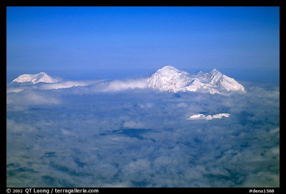 Mt Foraker and Mt Mc Kinley emerge from a sea of clouds. Denali National Park (color)