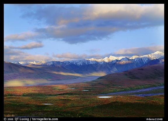 Tarn lakes, tundra, and snowy mountains of Alaska Range with patches of light. Denali  National Park (color)