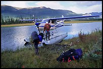 Backpackers beeing dropped off by a floatplane at Circle Lake. Gates of the Arctic National Park, Alaska (color)