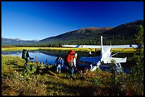 Backpackers beeing picked up by a floatplane at Circle Lake. Gates of the Arctic National Park, Alaska (color)