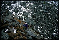 Backpacker in boulder field at the base of the Arrigetch Peaks. Gates of the Arctic National Park, Alaska (color)