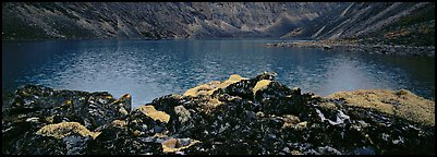 Dark rocks, lichen, and mountain lake. Gates of the Arctic National Park (Panoramic color)