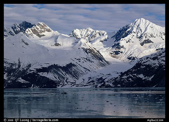 Coastal mountains with glacier dropping into icy fjord. Glacier Bay National Park (color)