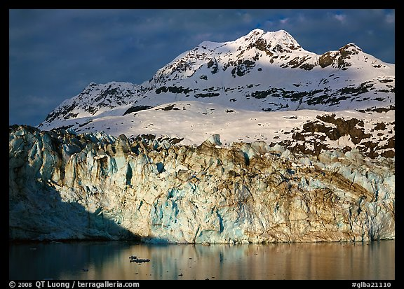 Face of Lamplugh Glacier illuminated by the sun on cloudy day. Glacier Bay National Park (color)