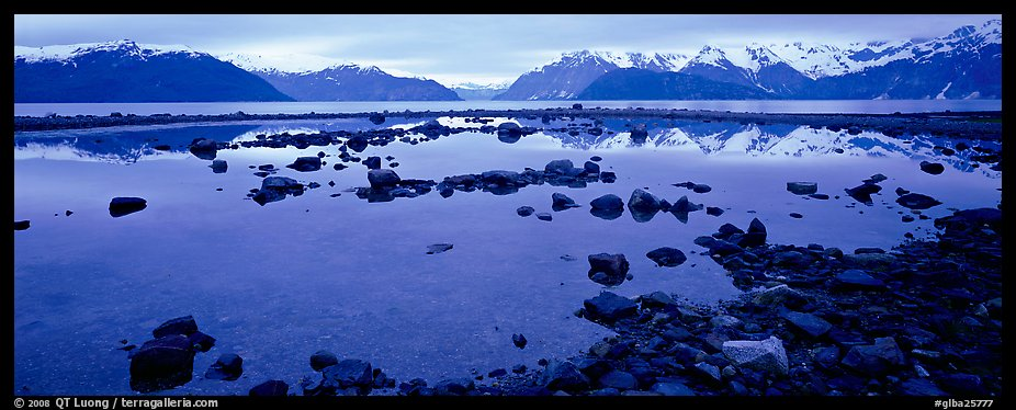 Blue scenery of water and mountains at dusk. Glacier Bay National Park (color)
