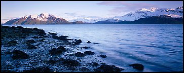 Fjord landscape with mountains rising above inlet. Glacier Bay National Park (Panoramic color)