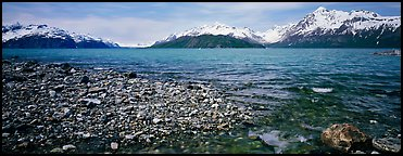 Snowy mountains rising above water. Glacier Bay National Park (Panoramic color)