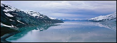Marine scenery with snowy mountains and ice. Glacier Bay National Park (Panoramic color)