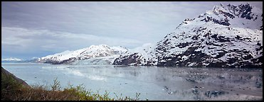 Snowy mountains rising above fjord. Glacier Bay National Park (Panoramic color)