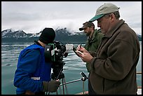 Team begins filming a movie sequence. Glacier Bay National Park, Alaska, USA. (color)