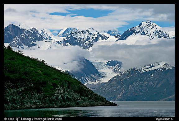 Peaks of Fairweather range with clearing clouds. Glacier Bay National Park (color)