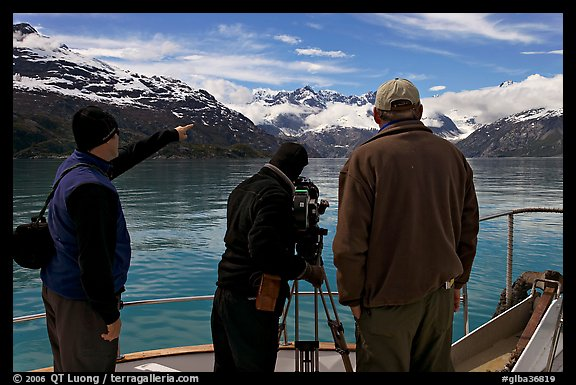 Crew filming from the deck of a boat. Glacier Bay National Park (color)