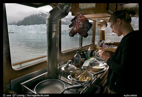 Woman preparing a breakfast aboard small tour boat. Glacier Bay National Park (color)
