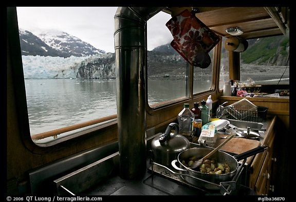 Breakfast potatoes in a small boat moored in front of glacier. Glacier Bay National Park (color)