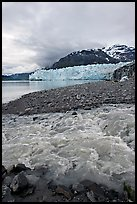 Stream flowing into Tarr Inlet, with Margerie Glacier in background. Glacier Bay National Park, Alaska, USA.
