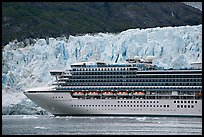 Cruise ship dwarfed by the face of Margerie Glacier. Glacier Bay National Park, Alaska, USA. (color)