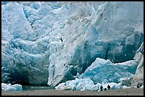 People at the base of Reid Glacier. Glacier Bay National Park, Alaska, USA. (color)