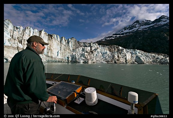 Captain guiding boat near Lamplugh glacier. Glacier Bay National Park (color)