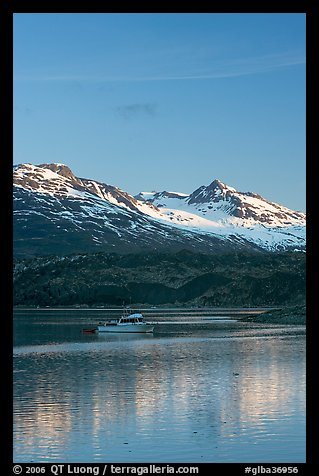 Small boat at the head of Tarr Inlet, early morning. Glacier Bay National Park (color)
