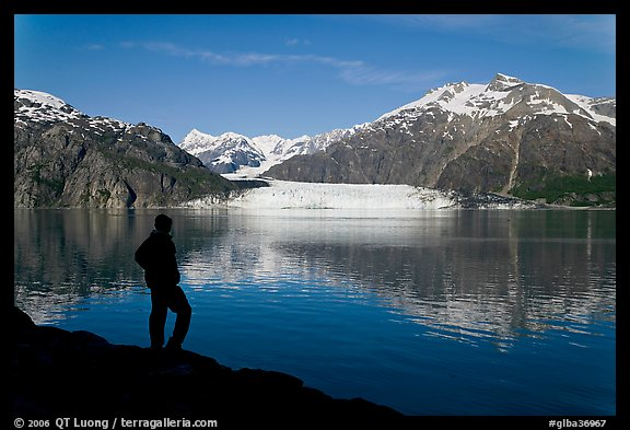 Man in silhouette looking at Tarr Inlet, Fairweather range and Margerie Glacier. Glacier Bay National Park (color)