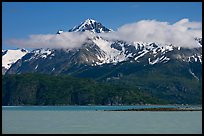 Snowy peaks and clouds raising above turquoise waters in sunny weather. Glacier Bay National Park ( color)