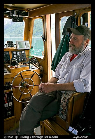 Captain sitting at the wheel. Glacier Bay National Park (color)