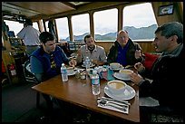 Passengers eating a soup for lunch. Glacier Bay National Park, Alaska, USA.