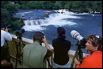 Photographers on observation platform and Brooks falls with bears. Katmai National Park, Alaska, USA.
