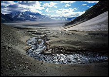 Stream flows from the hills into the floor of the Valley of Ten Thousand smokes. Katmai National Park ( color)
