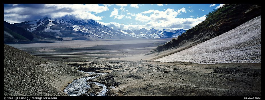 Stream flowing into arid ash-covered valley. Katmai National Park (color)