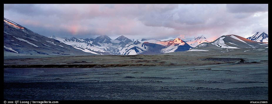 Desert-like ash-covered valley surrounded by snowy peaks. Katmai National Park (color)