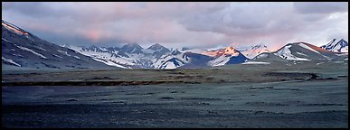 Desert-like ash-covered valley surrounded by snowy peaks. Katmai National Park (Panoramic color)