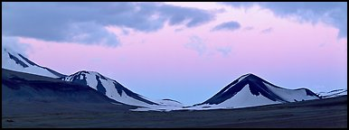 Snow-covered mountains with pink dusk sky. Katmai National Park (Panoramic color)
