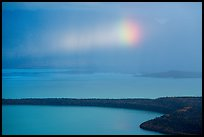 Rainbow in sun shaft piercing clouds. Katmai National Park ( color)