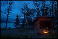 Camper sitting by campfire at night,  Brooks Camp. Katmai National Park ( color)