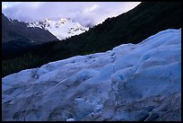 Alaskan Glacier seen from the side, and peaks. Kenai Fjords National Park, Alaska, USA.