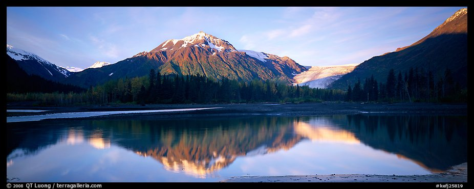 Mountains and glacier reflected in Resurrection River. Kenai Fjords National Park (color)