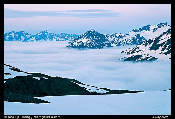 Mountains above low fog at dusk. Kenai Fjords National Park (color)
